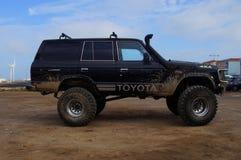 Toyota noire 4x4 Bigfoot Photographie stock libre de droits