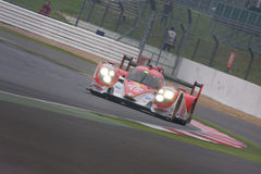 Toyota R1 LMP1 at Silverstone 6 Hours. Toyota R1 LMP1 at its debut race in the 6 hours of Silverstone 2014 powering through a bend royalty free stock photography