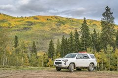 Toyota 4Runner at Kenosha Pass with fall colors. Kenosha Pass, CO, USA - September 14, 2017: Toyota 4Runner SUV 2016 Trail Premium Edition on a forest road in Stock Images