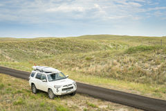 Toyota 4Runner SUV in Nebraska Sandhills. SENECA, NE, JULY 7, 2017: Toyota 4Runner SUV 2016 Trail edition carrying  a stand up paddleboard on a narrow back Royalty Free Stock Photos