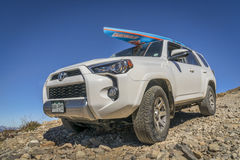 Toyota 4Runner SUV with paddleboard. LEADVILLE, CO, USA - SEPTEMBER 27, 2016: Toyota 4Runner SUV 2016 Trail edition with a paddleboard descending  from the Stock Photography