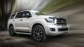 Toyota Sequoia. A white Toyota Sequoia car blurred in motion background stock photo