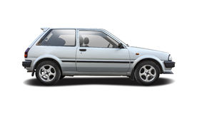 Toyota Starlet. Small hatchback city car side view  isolated on white Royalty Free Stock Photography