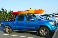Toyota Tacoma SUV loaded with kayak and bicycles Royalty Free Stock Image