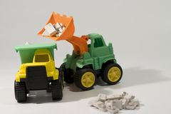Toys. Toy load truck loading keys to dump truck Stock Photo