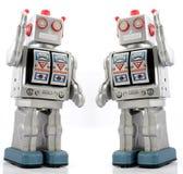 Toys. Two retro robot toys on white Royalty Free Stock Images