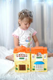 Toys. A child playing with toy-house Stock Photography