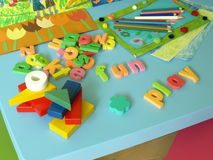 Toys. Puzzle, bricks, paintings and crayons for child royalty free stock photo