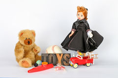 Toys. Assortment Of Vintage Children's Play Toys Against White Background Stock Images