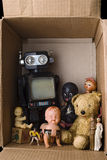 Toys. Vintage toys abandoned in a cardboard box Royalty Free Stock Photos