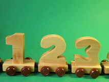 Toys. Wooden rating train for kids on green background Royalty Free Stock Image