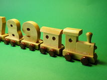 Toys. Rating wooden train for kids on the green background Royalty Free Stock Photography