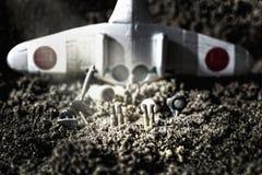 Toys airplane crash simulation Royalty Free Stock Photo