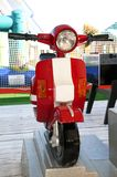 Toys in the amusement park. A red motorbike toy in a fairground Stock Image