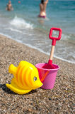 Toys at the beach. Toys in yellow and pink at the summer beach Royalty Free Stock Photos