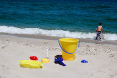 Toys on a beach Royalty Free Stock Photo