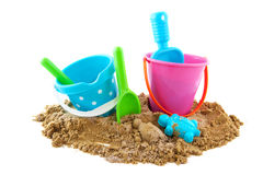 Toys at the beach. Plastic toys at the beach isolated over white Royalty Free Stock Photo