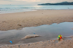 A toys on the beach. A toys when children leave away on the beach Royalty Free Stock Photo
