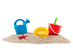 Toys at the beach. Plastic toys at the summer beach isolated over white background Royalty Free Stock Images