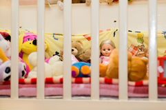 Toys in Bed. A lot of toys in a child's bed stock photography