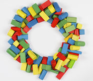 Toys blocks circle frame, multicolor wooden bricks. Toys blocks circle frame, multicolor wooden building bricks, group of colorful game pieces Royalty Free Stock Photo