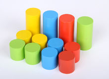 Toys blocks, multicolor wooden building bricks,. Cylindrical stock photography