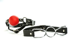 Toys for bondage: spider-gag and red ball-gag. Toys for bondage and role-playing: a spider-gag and a red ball-gag Royalty Free Stock Images