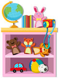 Toys and books on shelf Royalty Free Stock Photography
