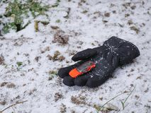 Toys car in the snow glove royalty free stock photos