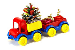 Toys, car-truck and Santa Claus with gift Royalty Free Stock Image