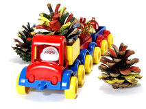 Toys, car-truck and Santa Claus with gift Stock Images