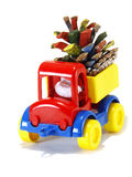Toys, car-truck and Santa Claus with gifts Royalty Free Stock Photos