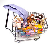 Toys in Cart. Children's toys in a metal shopping cart. White background Stock Photo