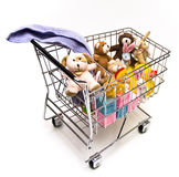 Toys in Cart. Children's toys in a metal shopping cart. White background Stock Image