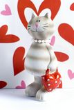 Toy cat and red hearts Stock Photos