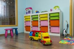 Toys and Children`s Furniture. Kids playroom with toys and furniture stock image