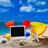 Toys for children's sandboxes against the sea and the beach Stock Photo