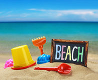 Toys for childrens sandboxes against the sea Stock Photography