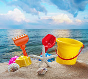 Toys for childrens sandboxes against the sea Royalty Free Stock Image
