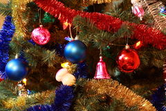 Toys on christmas tree firtree Royalty Free Stock Image