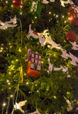 Toys on the Christmas tree, pigeons and houses. Stock Photo