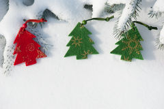 Toys on the christmas tree on snow Stock Photos