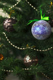 Toys closeup on the Christmas tree. Colorful toys closeup on the Christmas tree Stock Photography