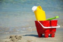 Toys closeup on sandy beach Royalty Free Stock Photography
