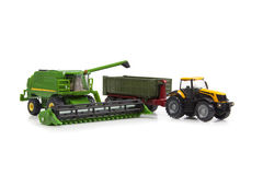 Toys combine harvester and tractor with semi-trailer Royalty Free Stock Image