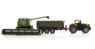 Toys combine harvester and tractor with semi-trailer Royalty Free Stock Images