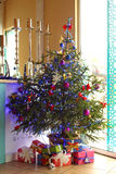 Toys decorated their Christmas tree with gifts. On the background of the bar Royalty Free Stock Images