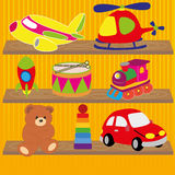 Toys. Different toys on special yellow lines background Stock Photos