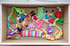 Toys and dolls made from colorful loom bands Royalty Free Stock Photos