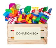 Toys donations box isolated on white background stock photo